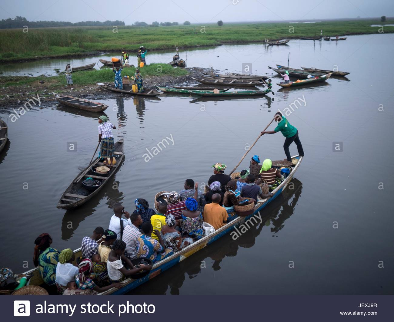 People commuting by boat. - Stock Image