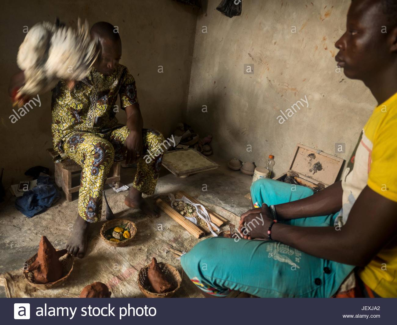 Fetishes on the floor by an herbal healer, doing a Vossissa treatment on a patient. - Stock Image