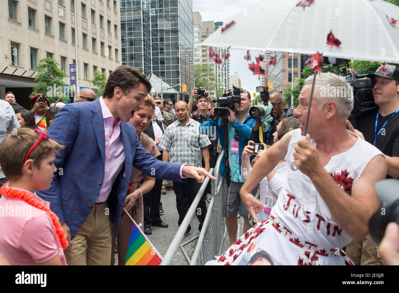 Toronto, Canada. 25 June 2017. Canadian Prime Minister Justin Trudeau greets fan Jamie Godin and looks at his 'Justin' - Stock Image