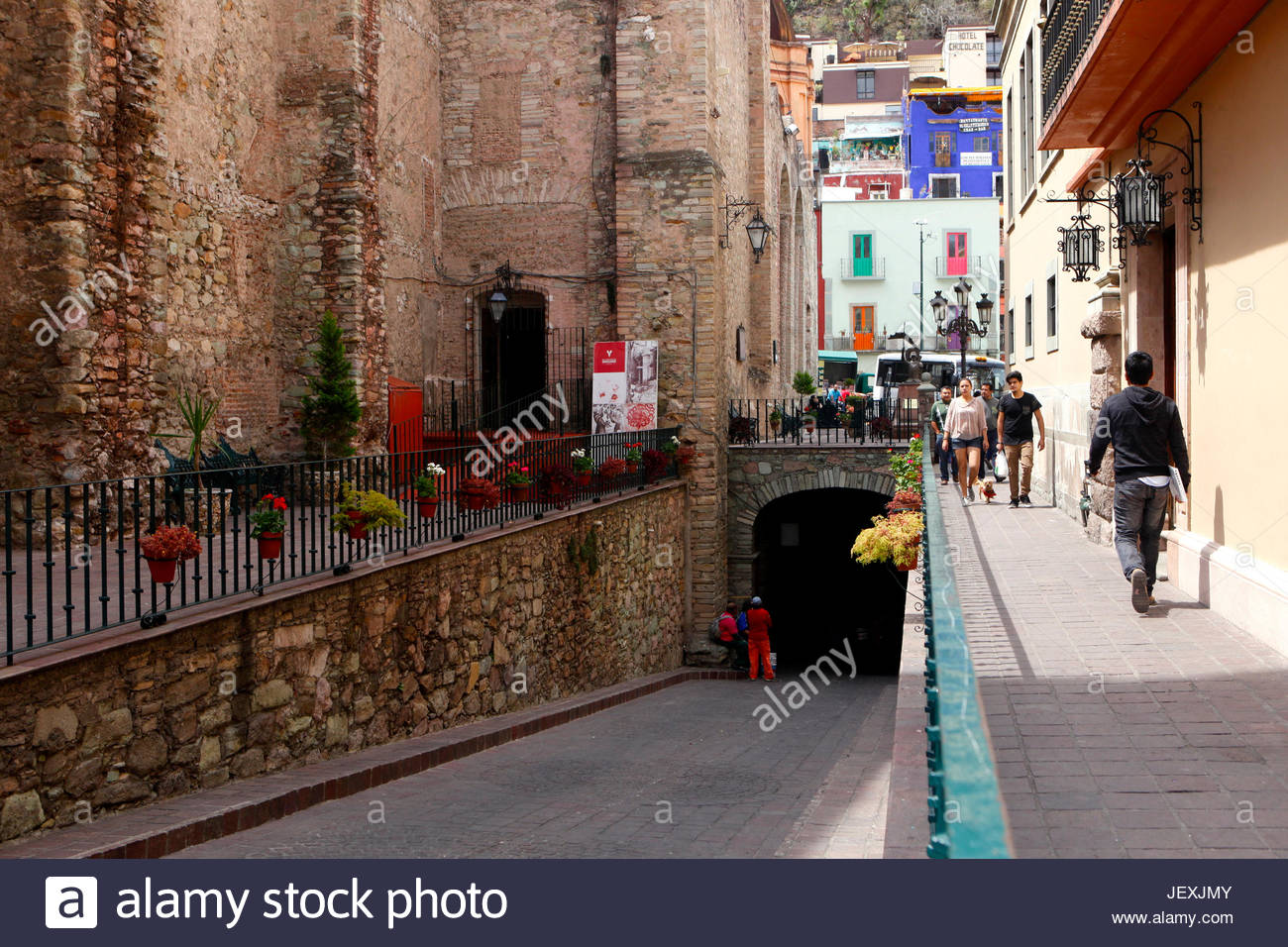 An entrance to one of many tunnels used for vehicular traffic, leaving the overground streets for pedestrians. - Stock Image