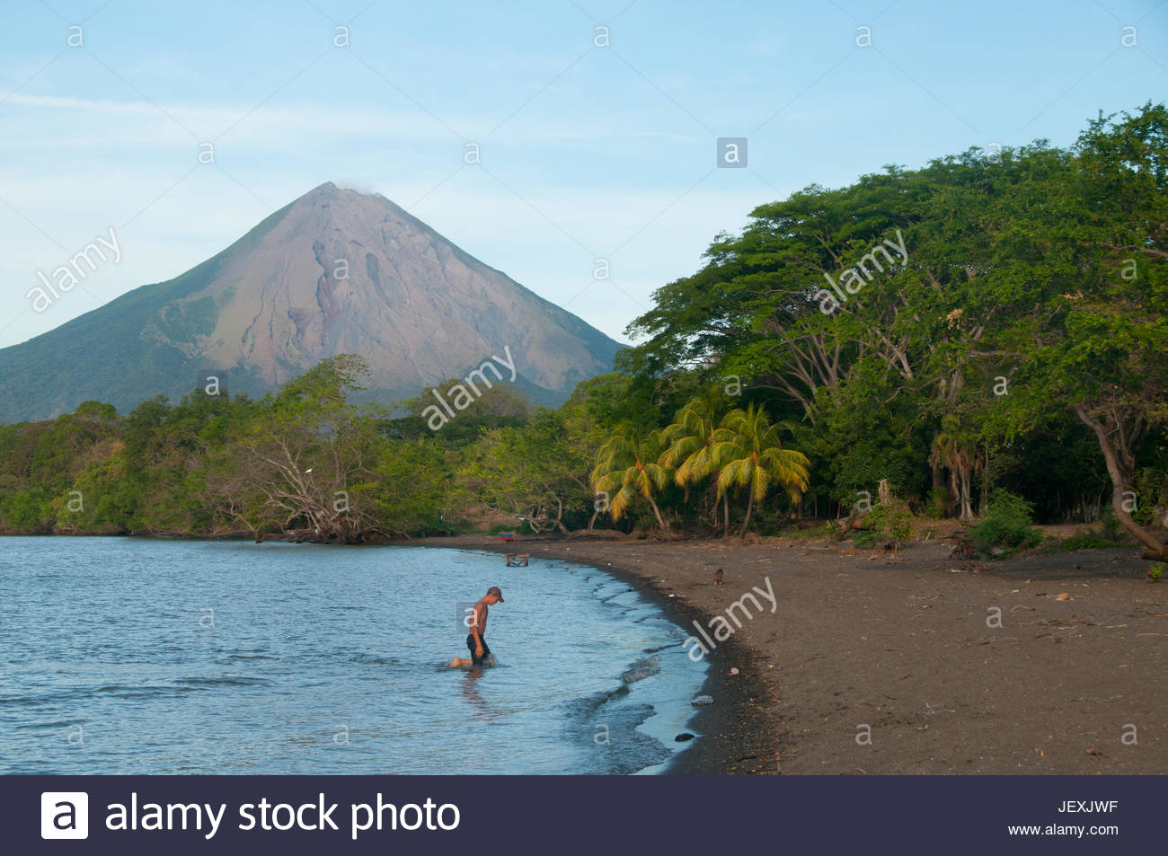 Locals from the Ometepe Island swimming in Lake Cocibolca, or Lake Nicaragua. - Stock Image