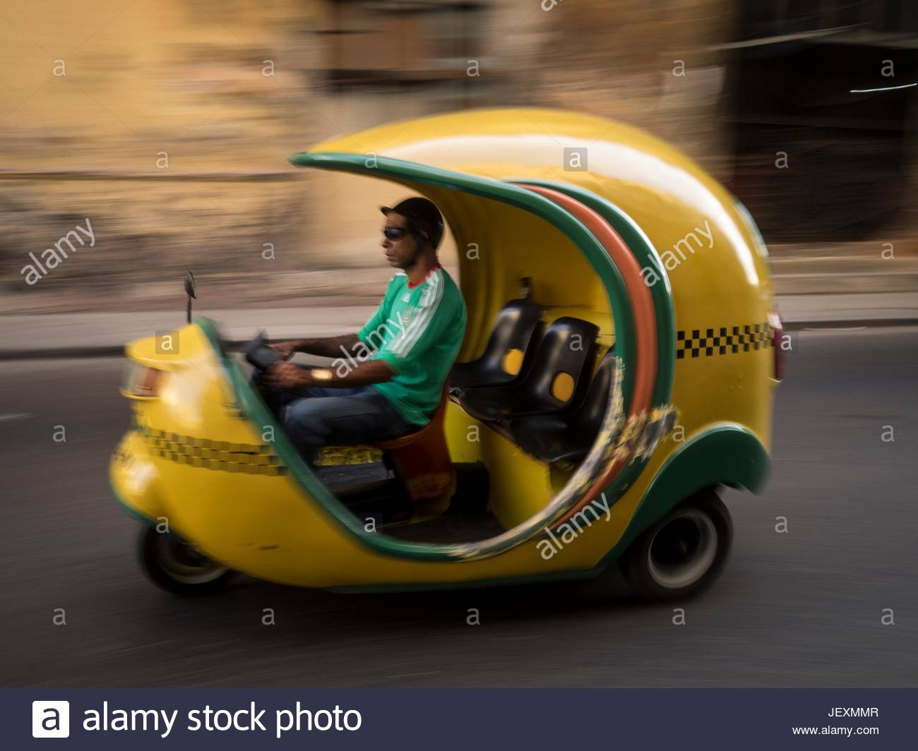 A cocotaxi or motorized rickshaw in the Calle Colon in La Habana Vieja. - Stock Image