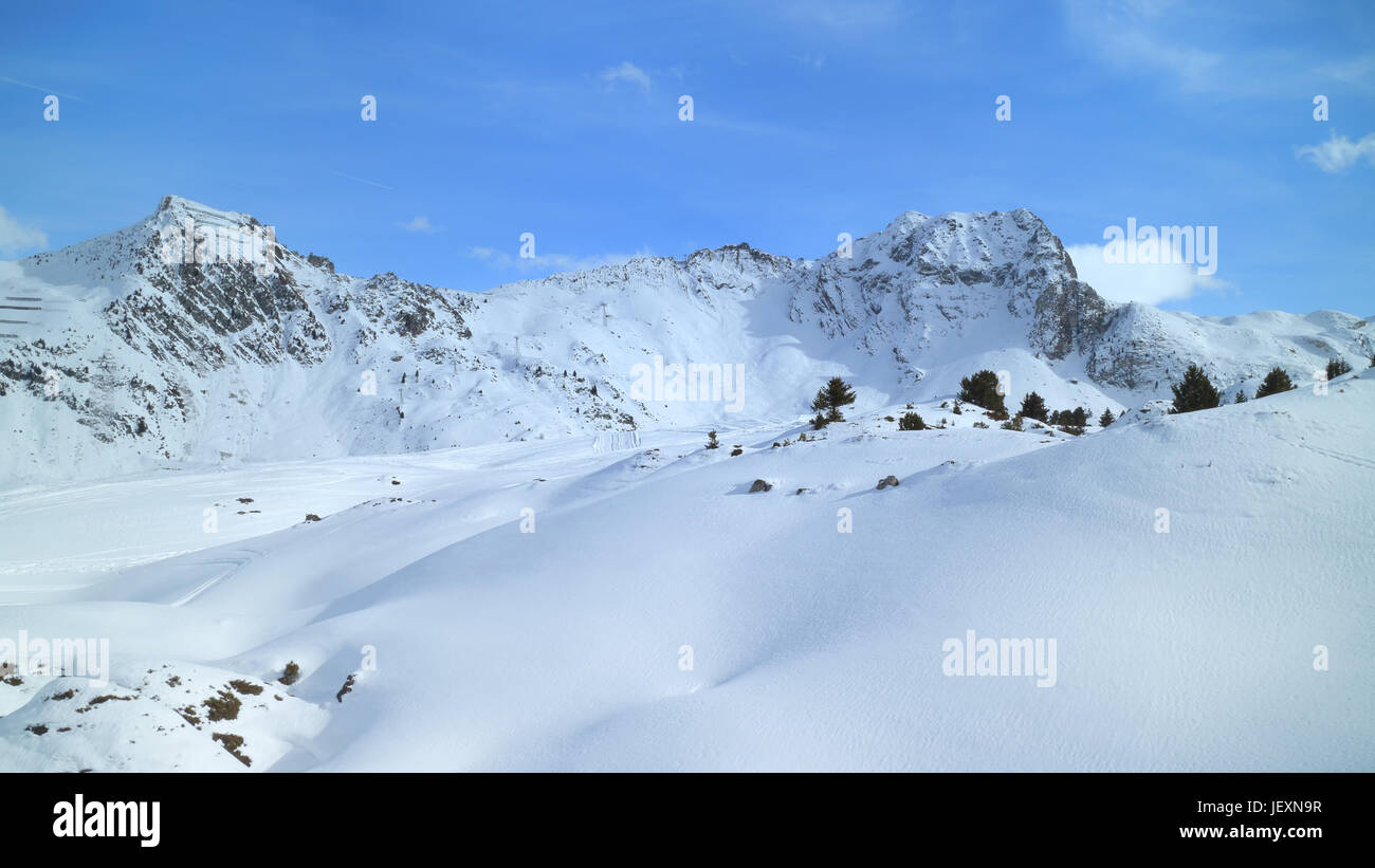 Winter mountain panoramic landscape with fresh snow on skiing tracks, Les Arcs slopes, Alps, France - Stock Image