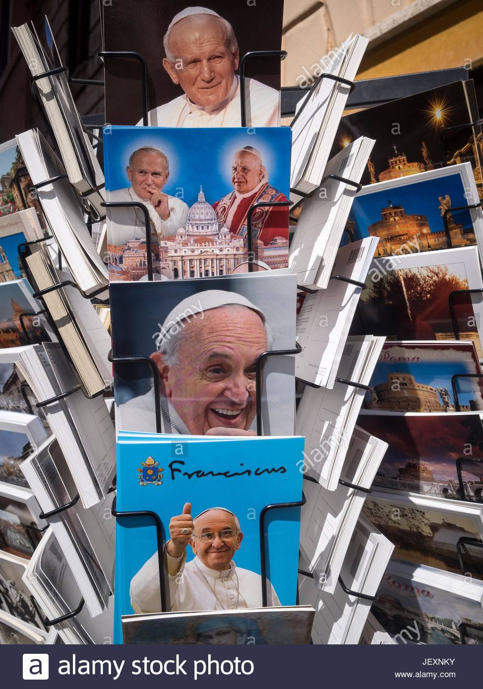 A postcard stand in Saint Peter's Square with postcards of Pope John Paul II and Pope Francis - Stock Image