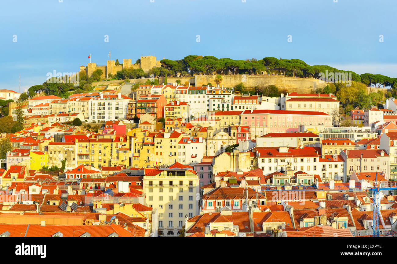 Panorama of Lisbon with Lisbon Castle on top of a hill at sunset. Portugal - Stock Image