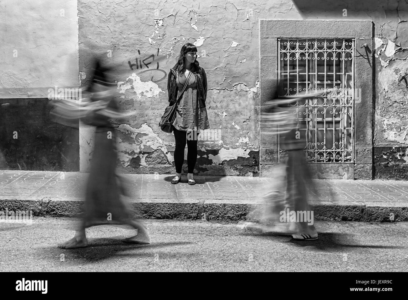 Linares, jaen province, SPAIN - March 16, 2014: Girl still watching how they spend nazarenos carrying a cross at - Stock Image