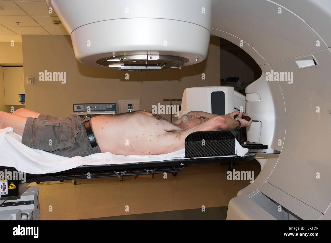 Patient Radiation therapy showing laser lines for targeting cancer cells in the brain and Throat - Stock Image