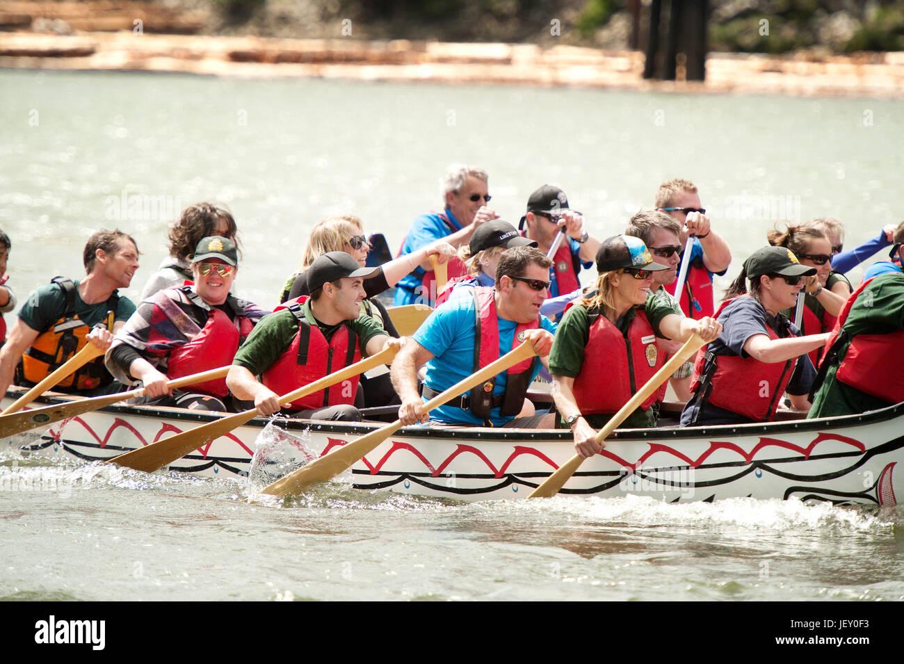 National Aboriginal Day canoe races at the Stawamus Waterfront.  Squamish BC, Canada. - Stock Image