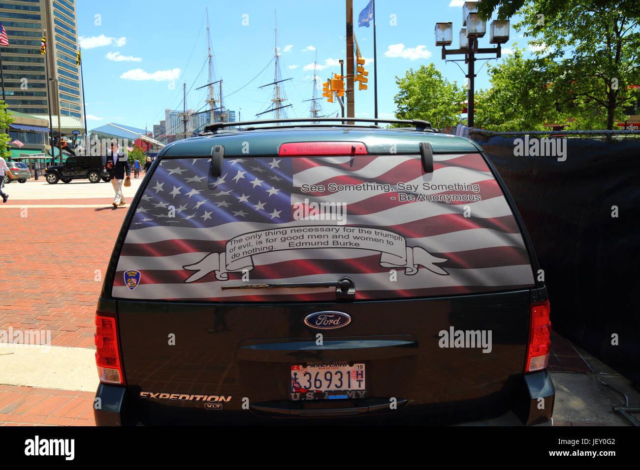 See Something say Something slogan, Edmund Burke quotation and American flag on rear window of Ford Expedition SUV, - Stock Image