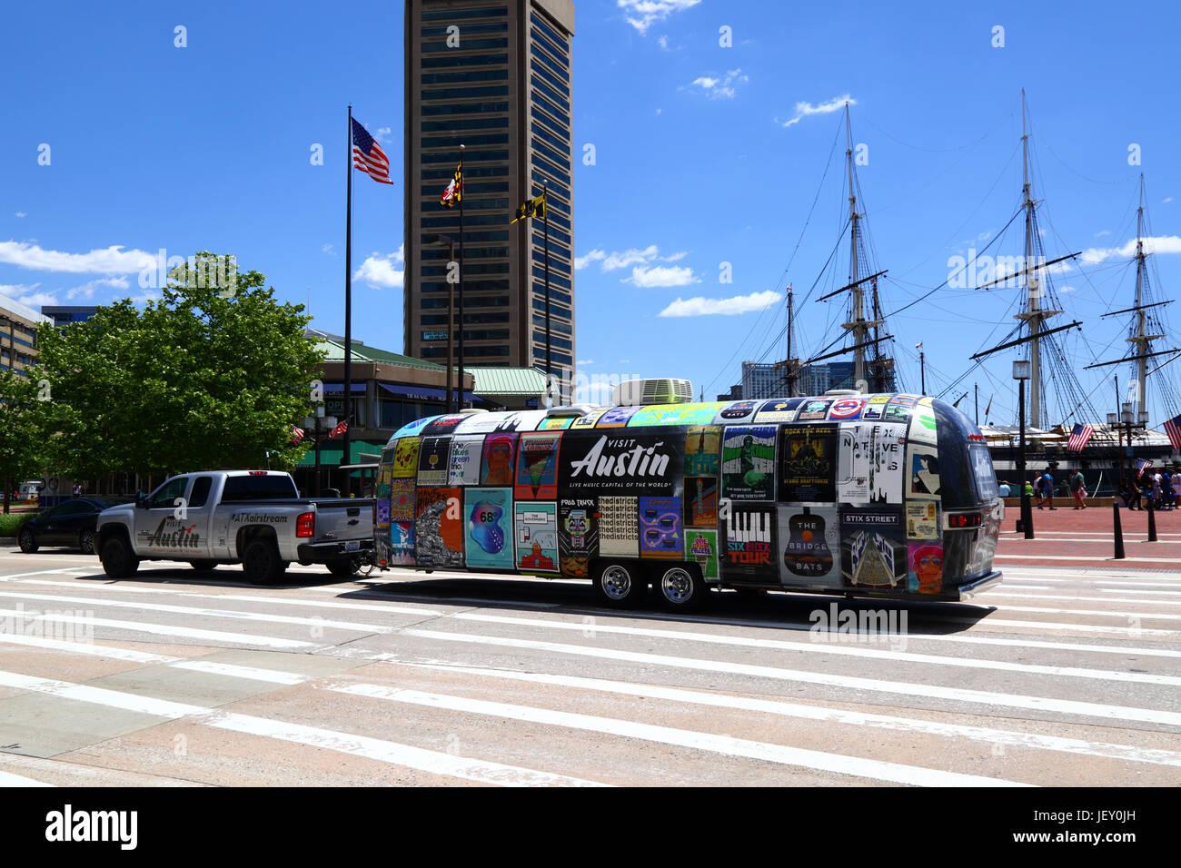 Pickup truck towing Airstream camper promoting Visit Austin