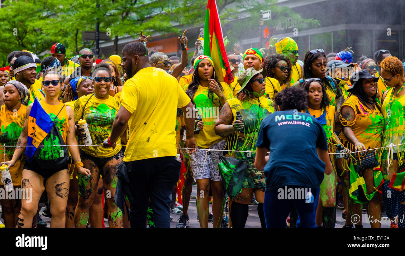 Carnival people marching in Caribbean parade in Montreal Canada - Stock Image