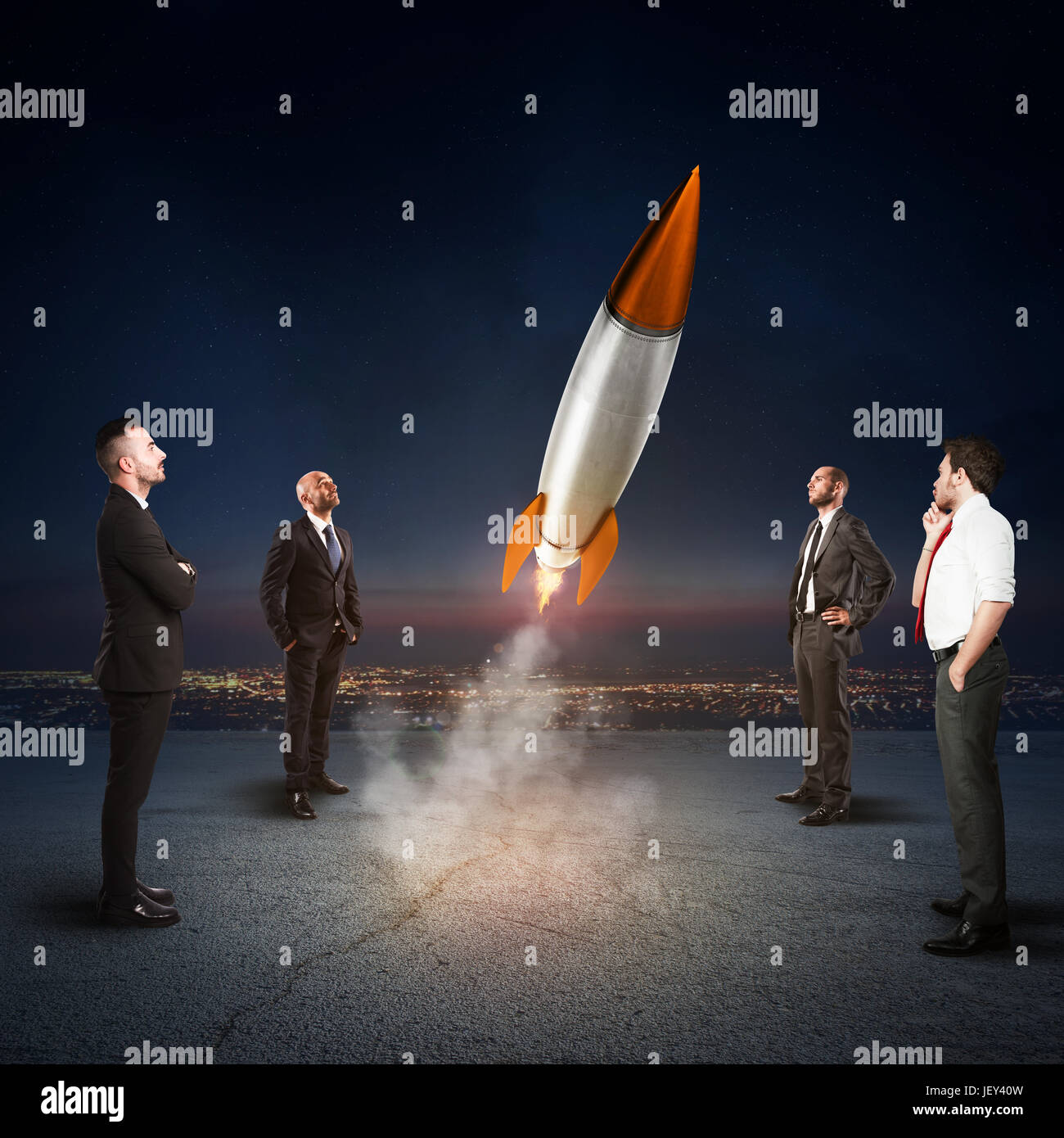 Team of businesspeople looks start a missile. Concept of company startup and new business. 3D Rendering. - Stock Image