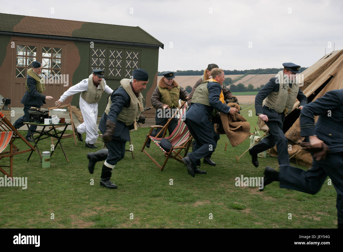 Battle of Britain scramble re-enactment Ops3945 with some photoediting applied to periodise any modern features - Stock Image