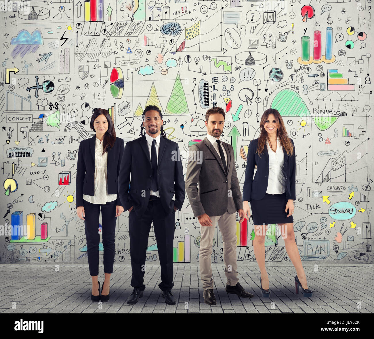 Group of successful men and women business people work on a creative project. Team and corporate concept - Stock Image
