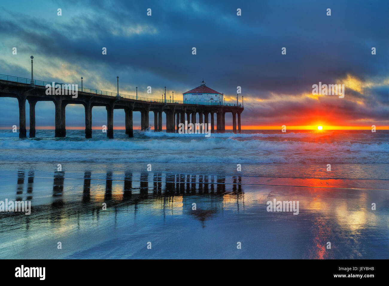 Sunset Over The Pacific Ocean At The Manhattan Beach Pier Stock