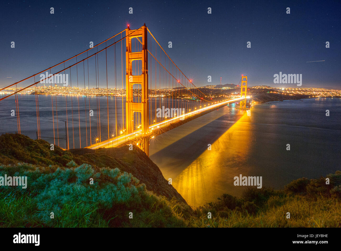 The iconic Golden Gate Bridge with San Francisco in the background photographed at night from the Golden Gate Bridge Stock Photo