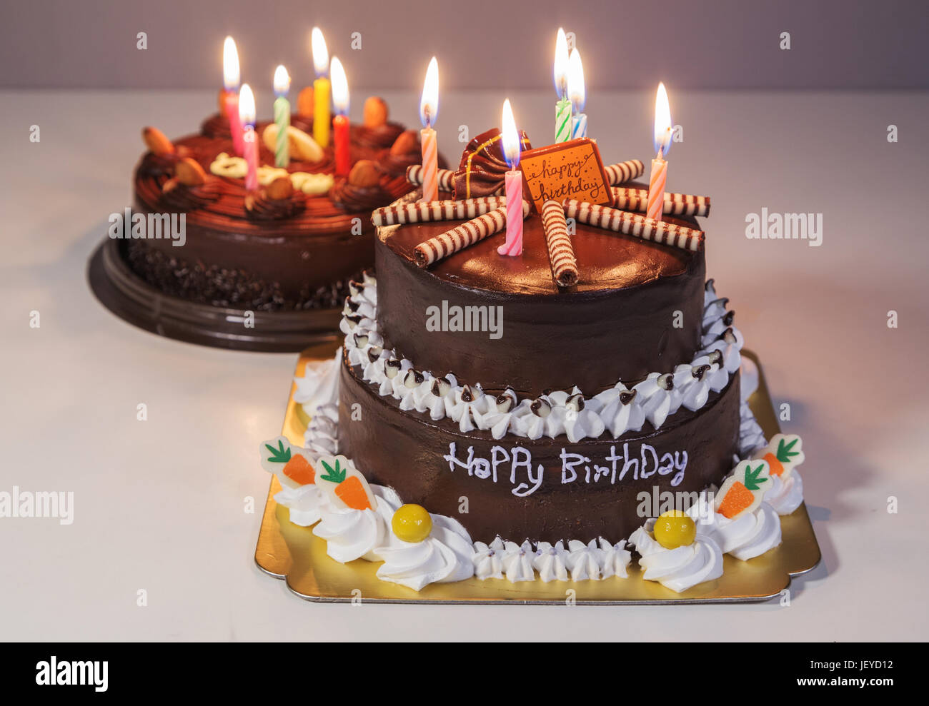 Wondrous Two Chocolate Cake With Happy Birthday Light Candle Stock Photo Personalised Birthday Cards Veneteletsinfo
