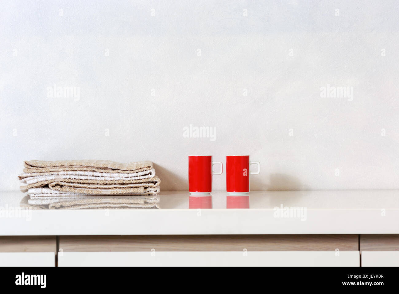 Detail Of Two Cups And Kitchen Rags On A Kitchen Countertop.   Stock Image
