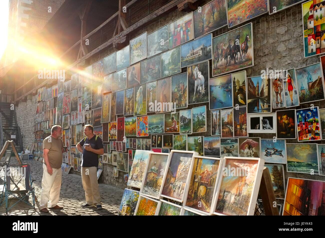 Paintings and artwork on sale in the Old Town of Krakow, Poland, Central/Eastern Europe, June 2017. Stock Photo