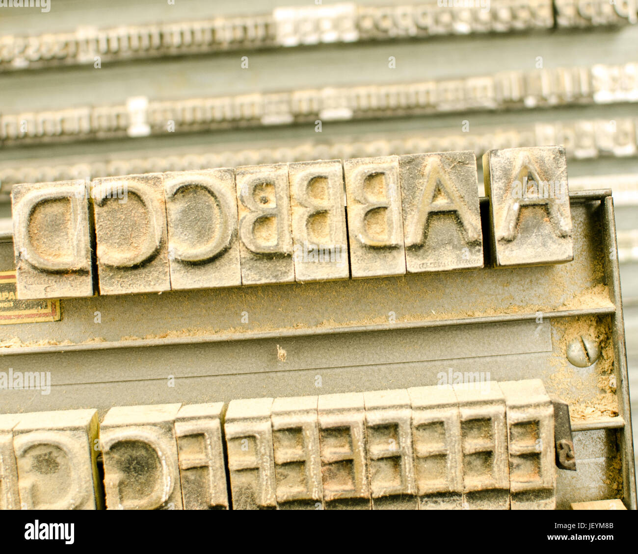 A rack of old printer's letters in a community art center. - Stock Image