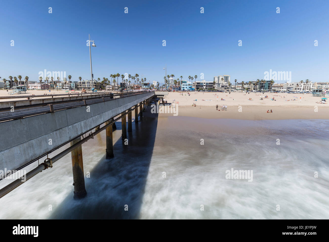 Los Angeles, California, USA - June 26, 2017:  Venice beach pier with motion blur waves. - Stock Image