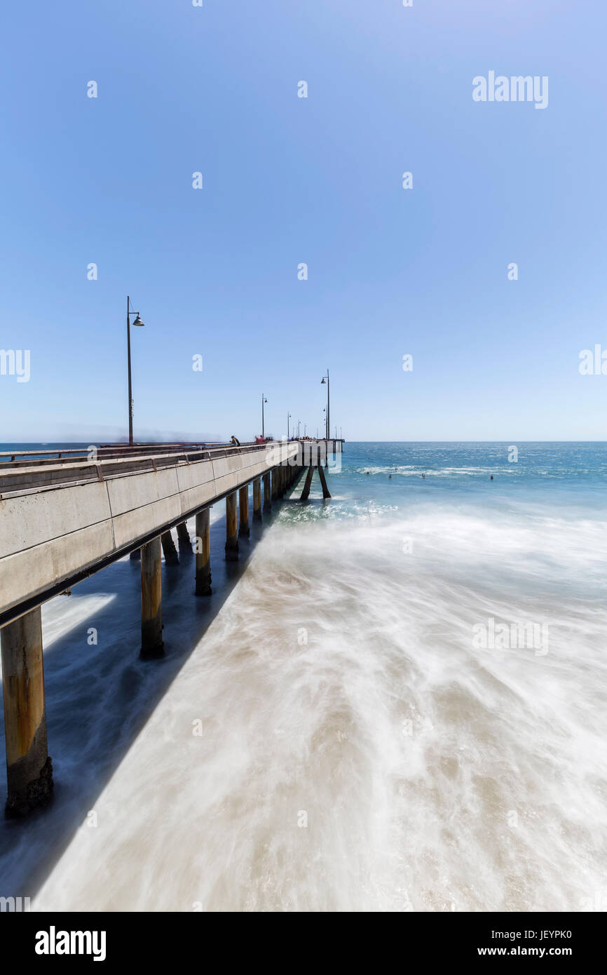 Venice Pier with motion blur waves in Los Angeles, California. - Stock Image