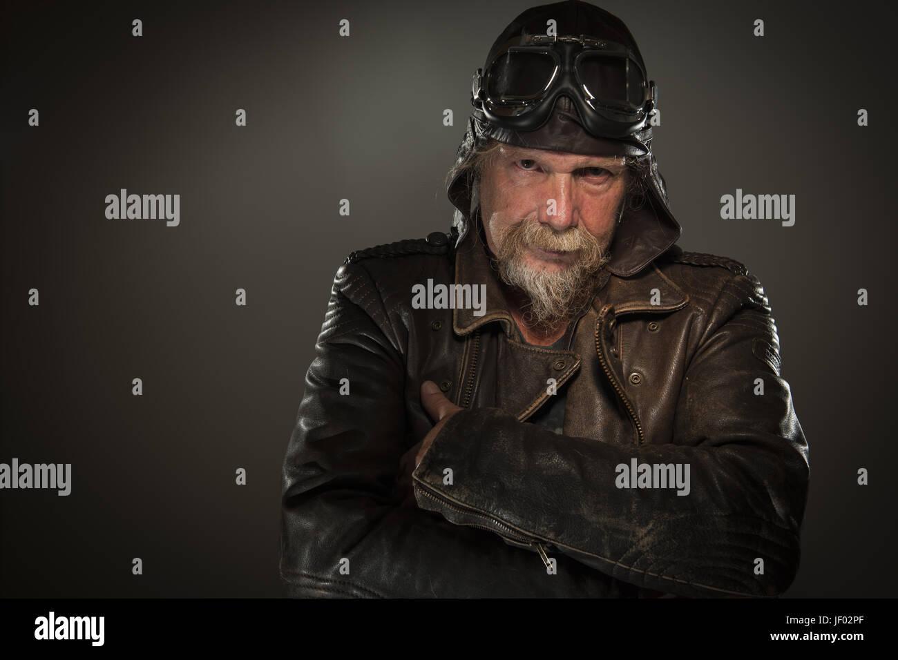 grim-looking biker Stock Photo