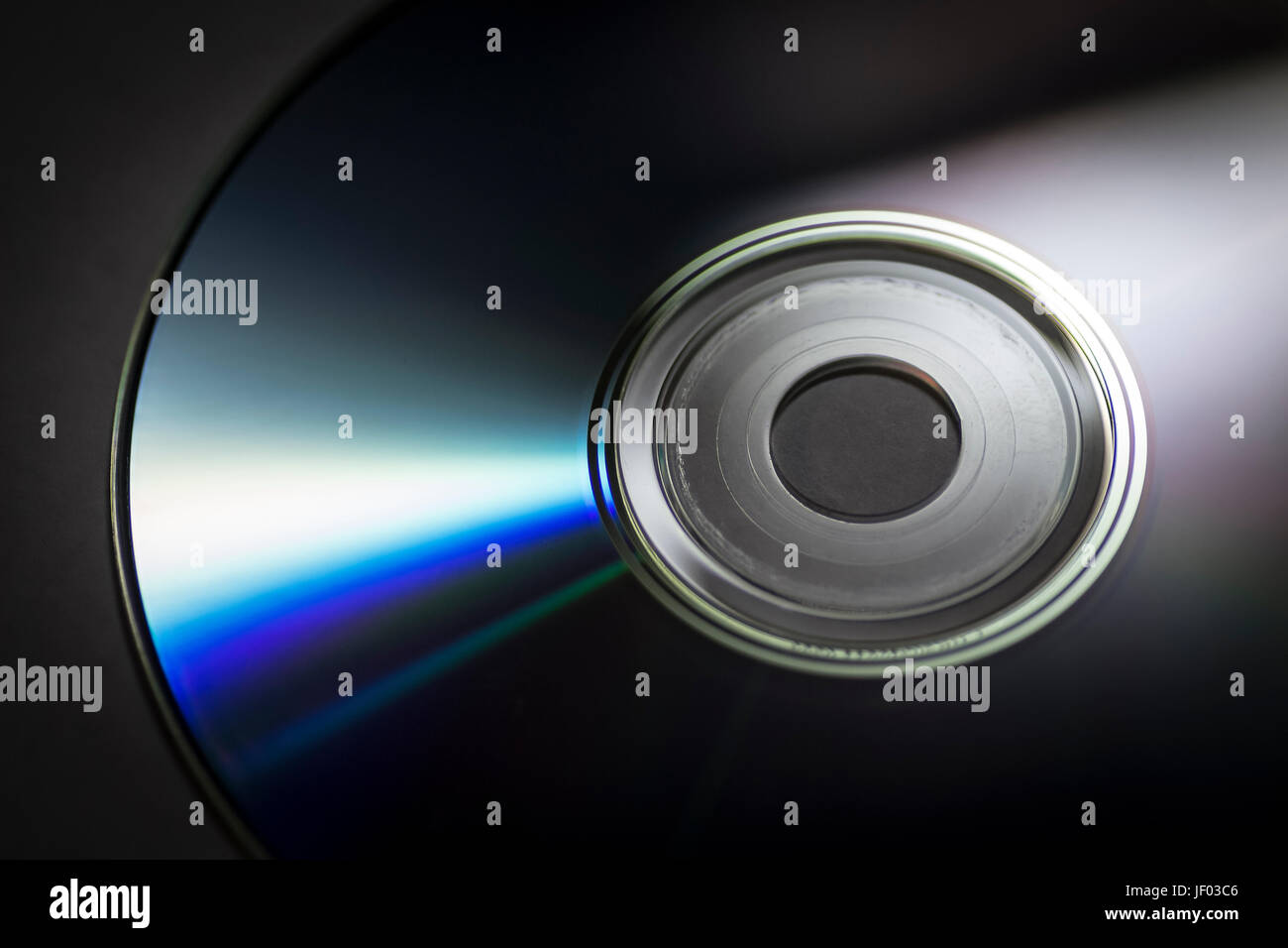 Compact disc close-up on a dark background. - Stock Image