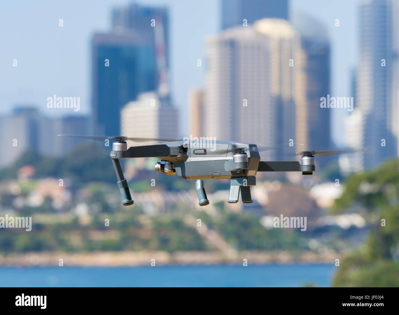 Drone flying near city centre - Stock Image