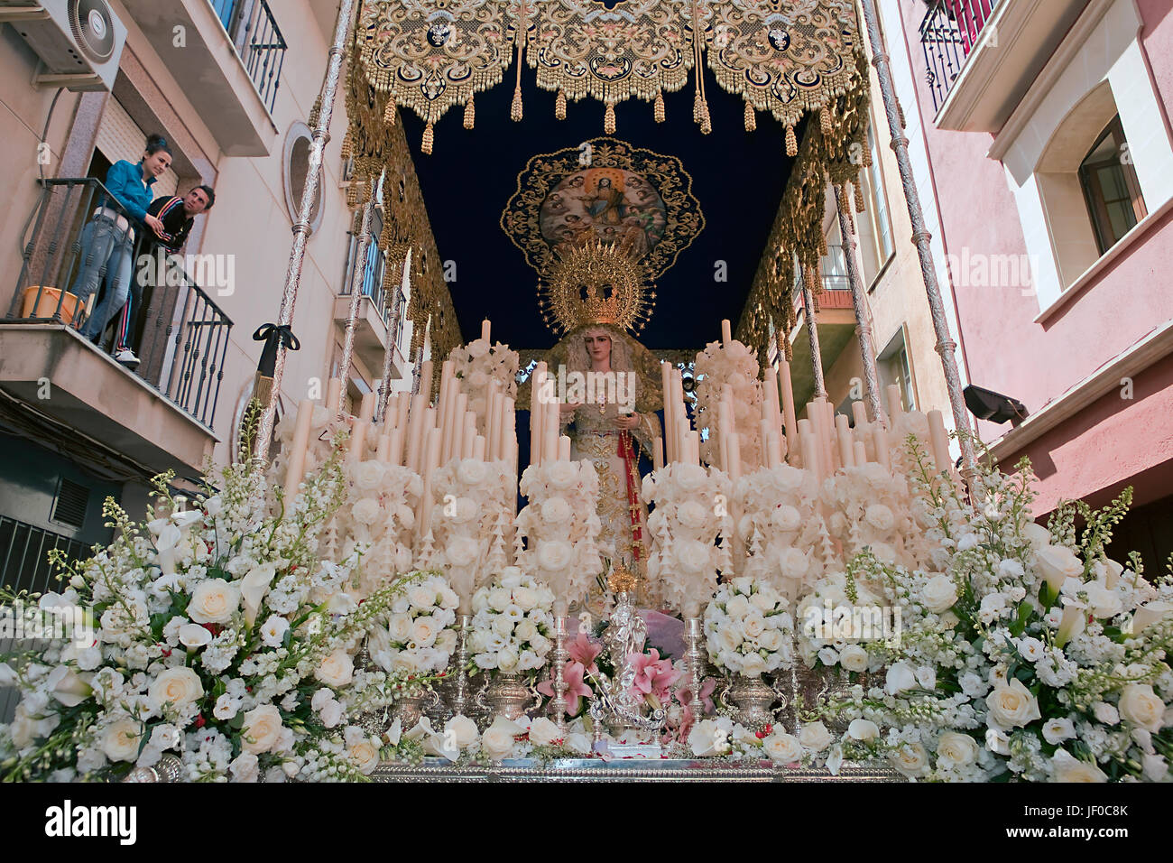 Front with candles, embroidered fabric and flowers of the throne of the Nuestra Se–ora del Amor Hermoso, Linares, - Stock Image