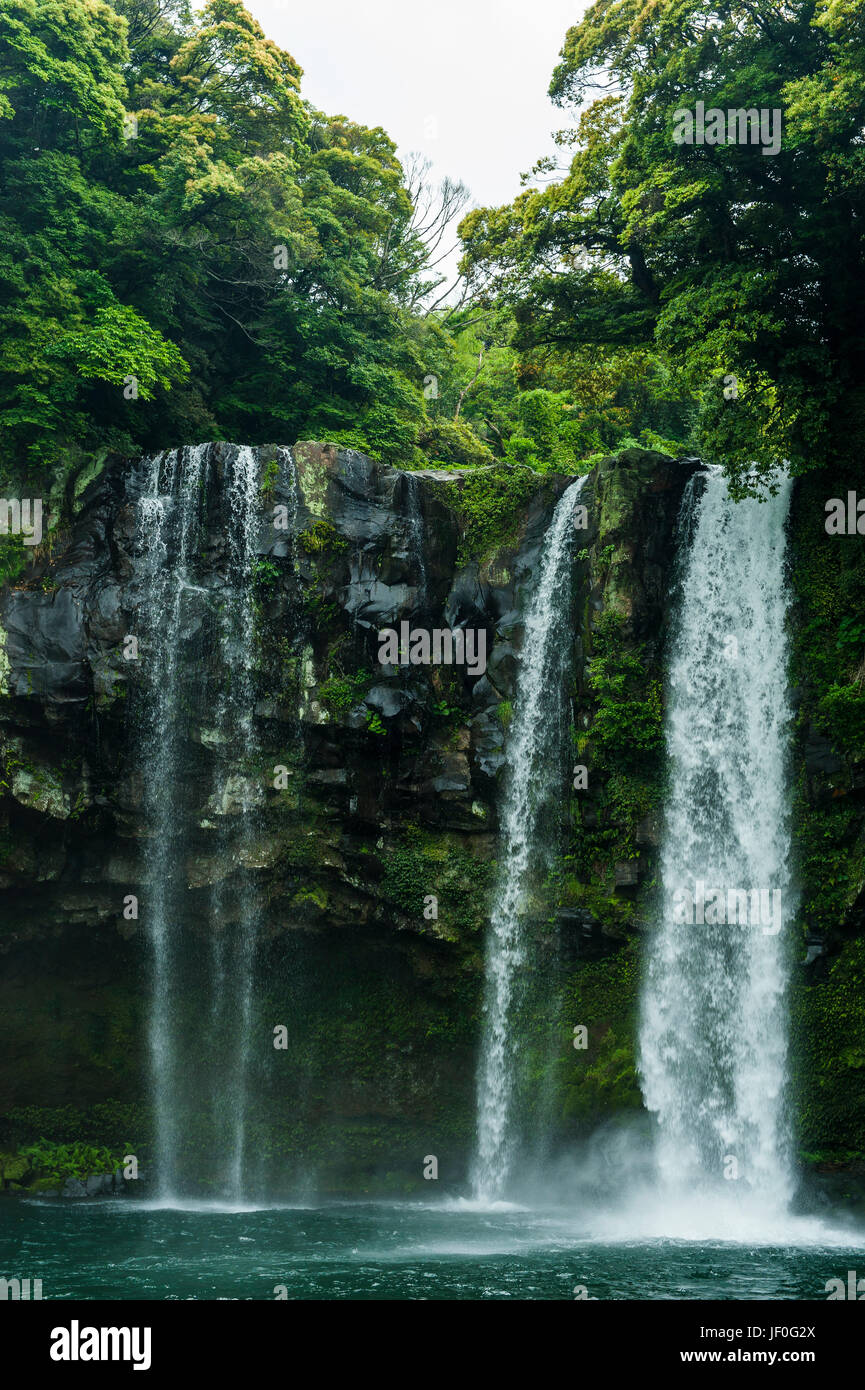 Cheonjiyeon pokpo waterfall, Unesco world heritage sight the island of Jejudo, South Korea - Stock Image