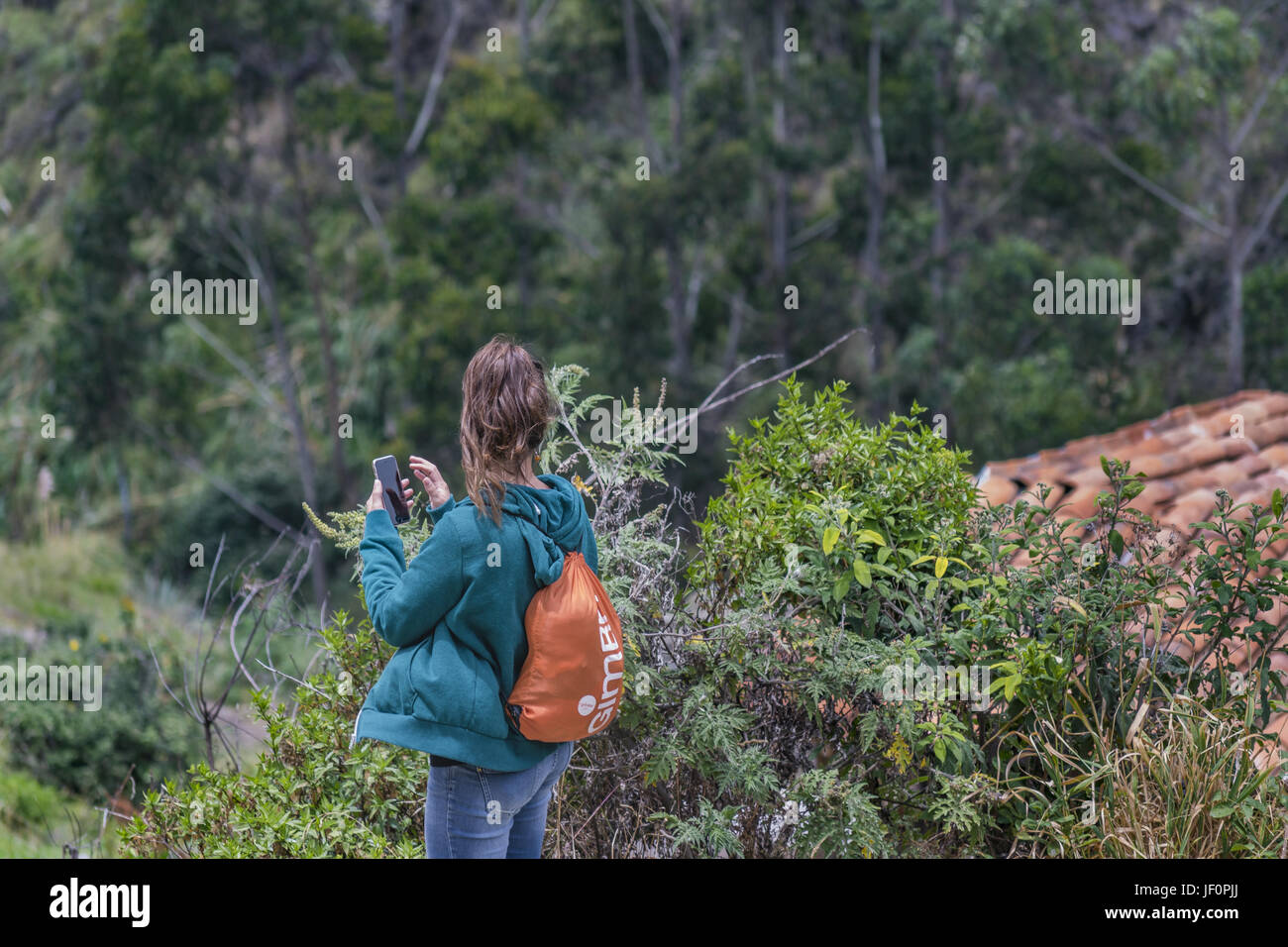Young Backpacker Woman at Ingapirca Ecuador - Stock Image