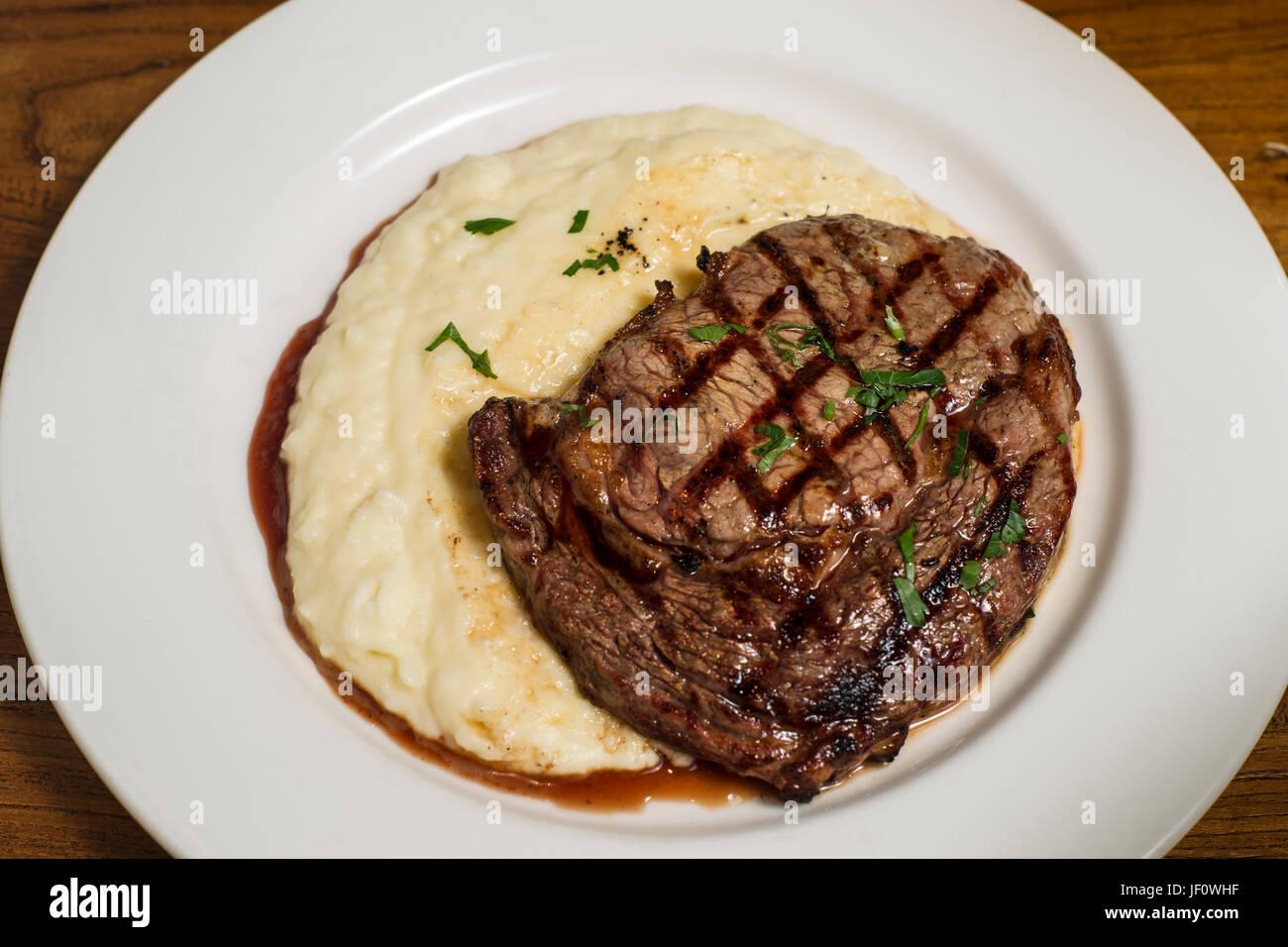 Beef steak with mash potato on white plate - Stock Image