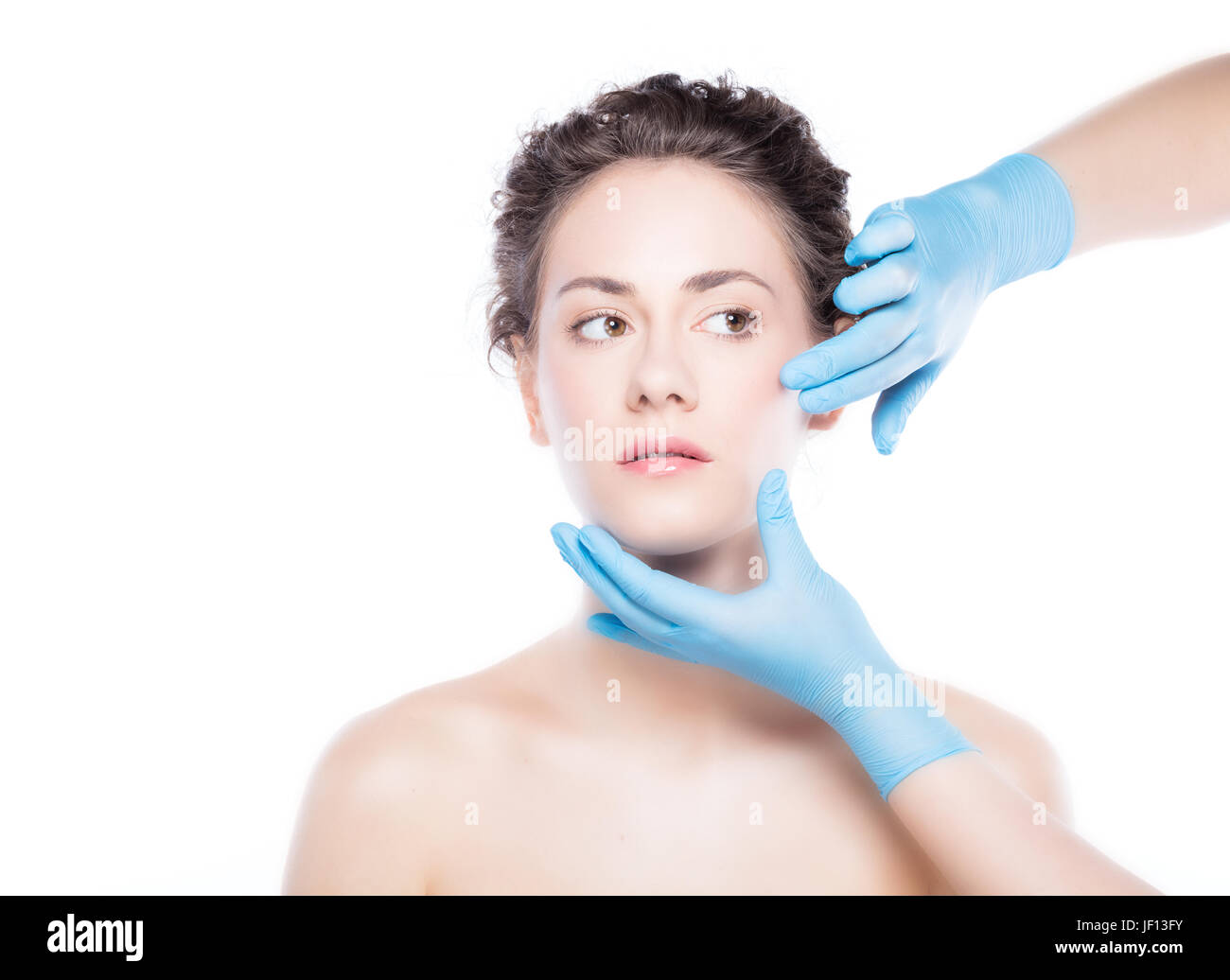 Aesthetic medicine. Young beautiful woman's skin review before treatment. Anti-aging skincare and plastic surgery - Stock Image