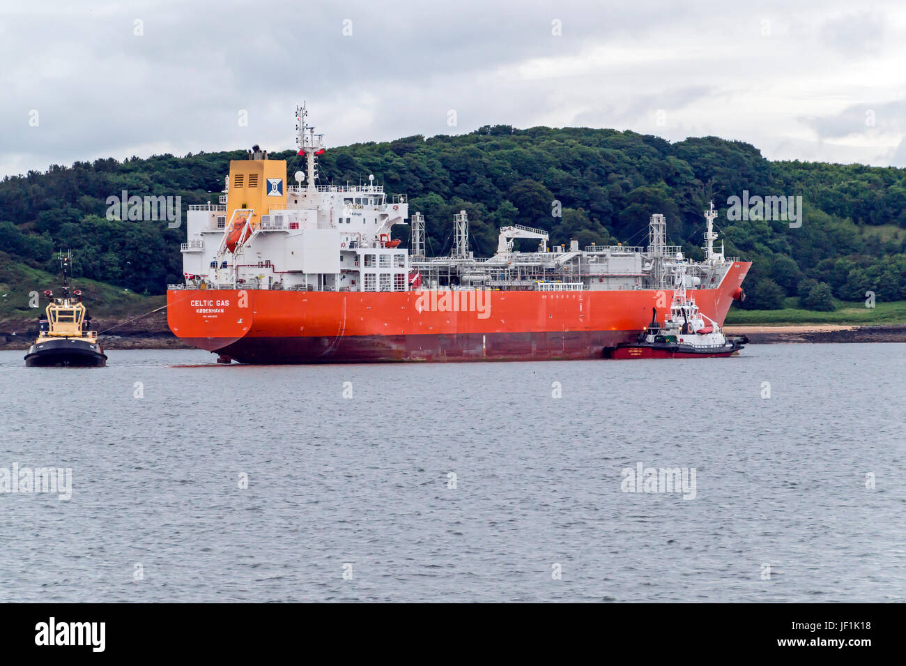Gas tanker Celtic Gas being assisted of tugs to enter Braefoot Bay Marine Terminal in Firth of Forth near Aberdour - Stock Image