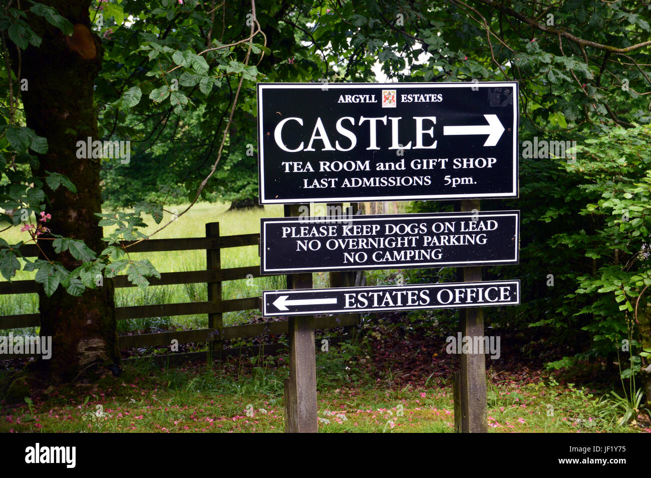 Signpost Outside Inveraray Castle which is the home of the Duke and Duchess of Argyll, West Scotland, UK. - Stock Image