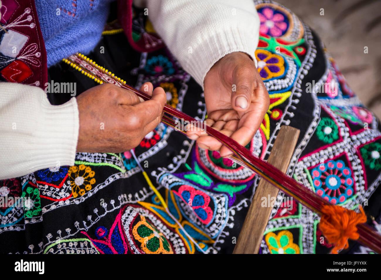 Close-up Of Peruvian Woman Weaving - Stock Image