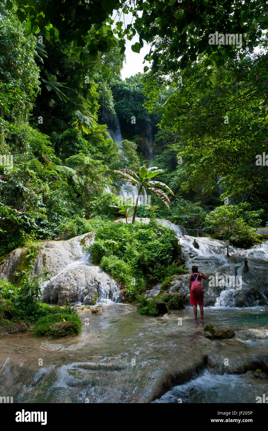 Woman looking at the beautiful Mele-Maat cascades in Port Vila, Island of Efate, Vanuatu, South Pacific, MR Stock Photo