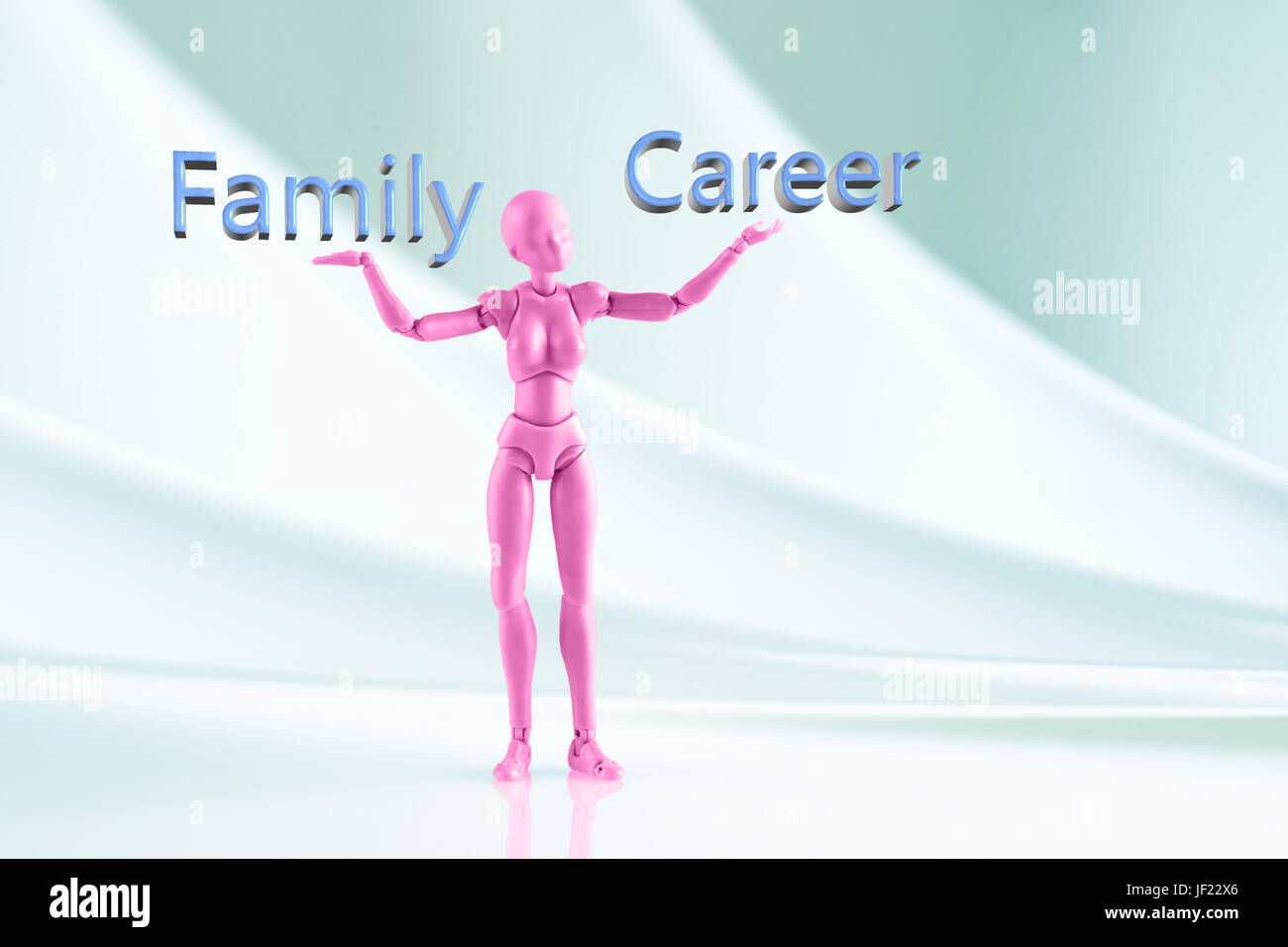 Pink female figurine standing on beautiful fabric background with words Family and Career. Concept of choice between Stock Photo