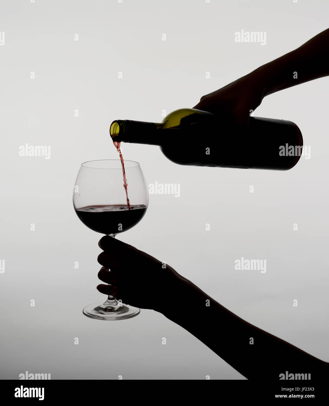 woman pouring red wine - Stock Image