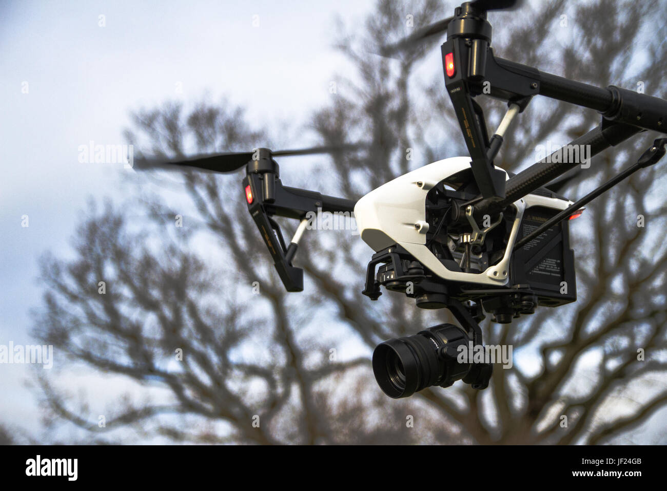 A DJI Inspire 1 Pro with a Zenmuse X5 Camera payload in flight. - Stock Image