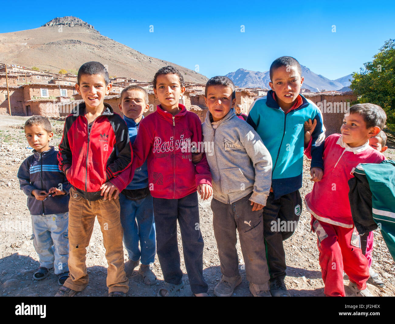 A group of inquisitive children in a remote village in the Atlas mountains of Morocco - Stock Image