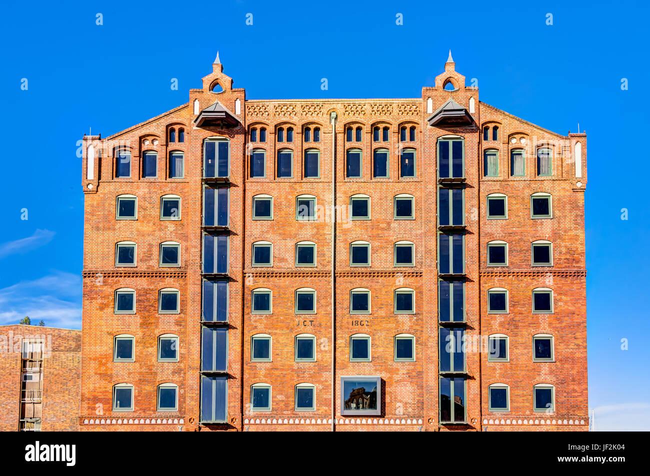 Historic harbor warehouses in Wismar - Stock Image