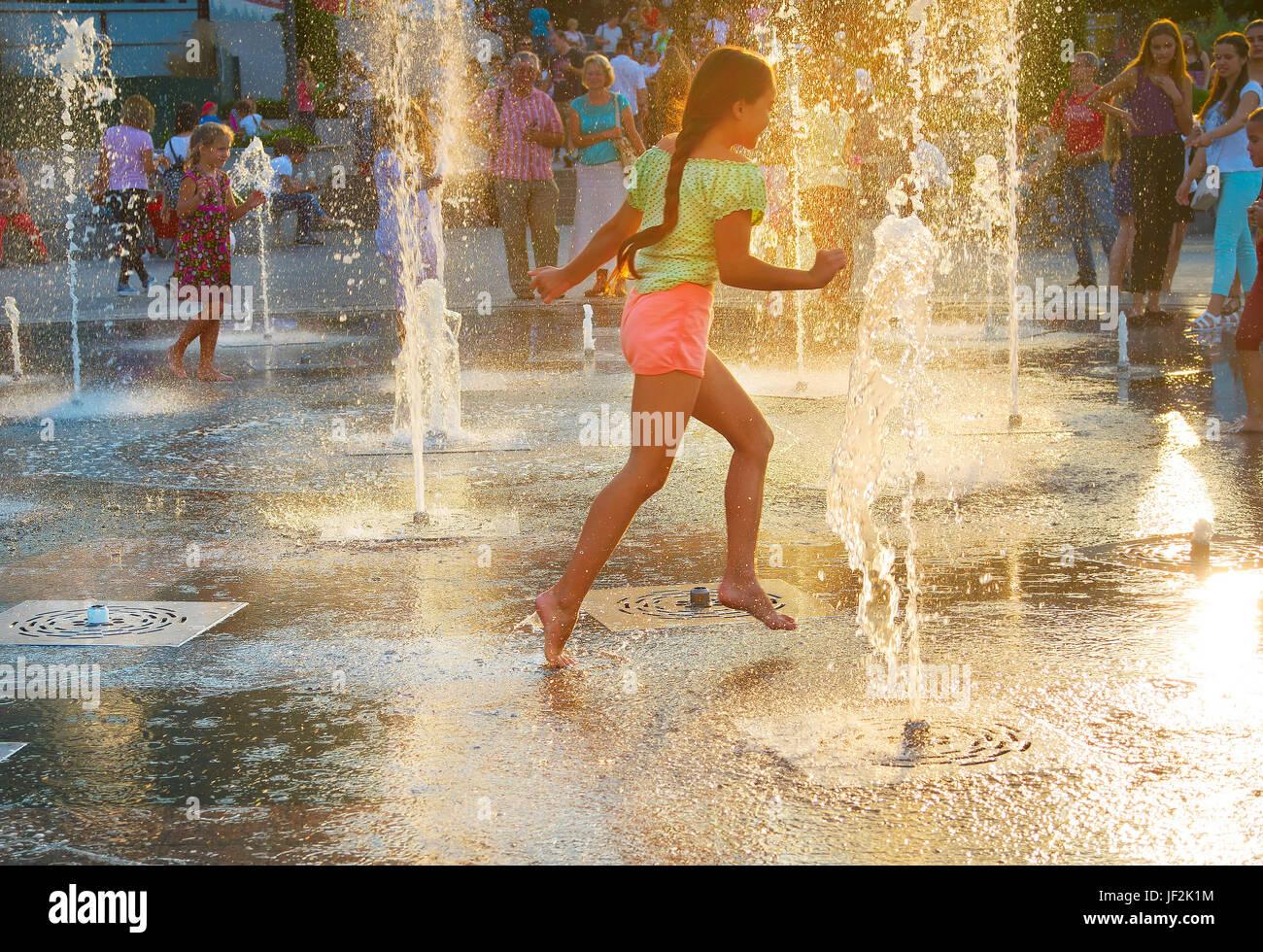Beautiful girl in a fountain Stock Photo
