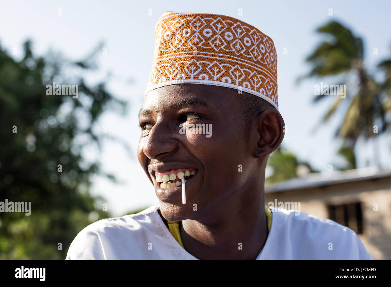 Portrait of young boy dressed in traditional kanzu and kofia (embroidered hat) attends the Maulidi celebrations - Stock Image