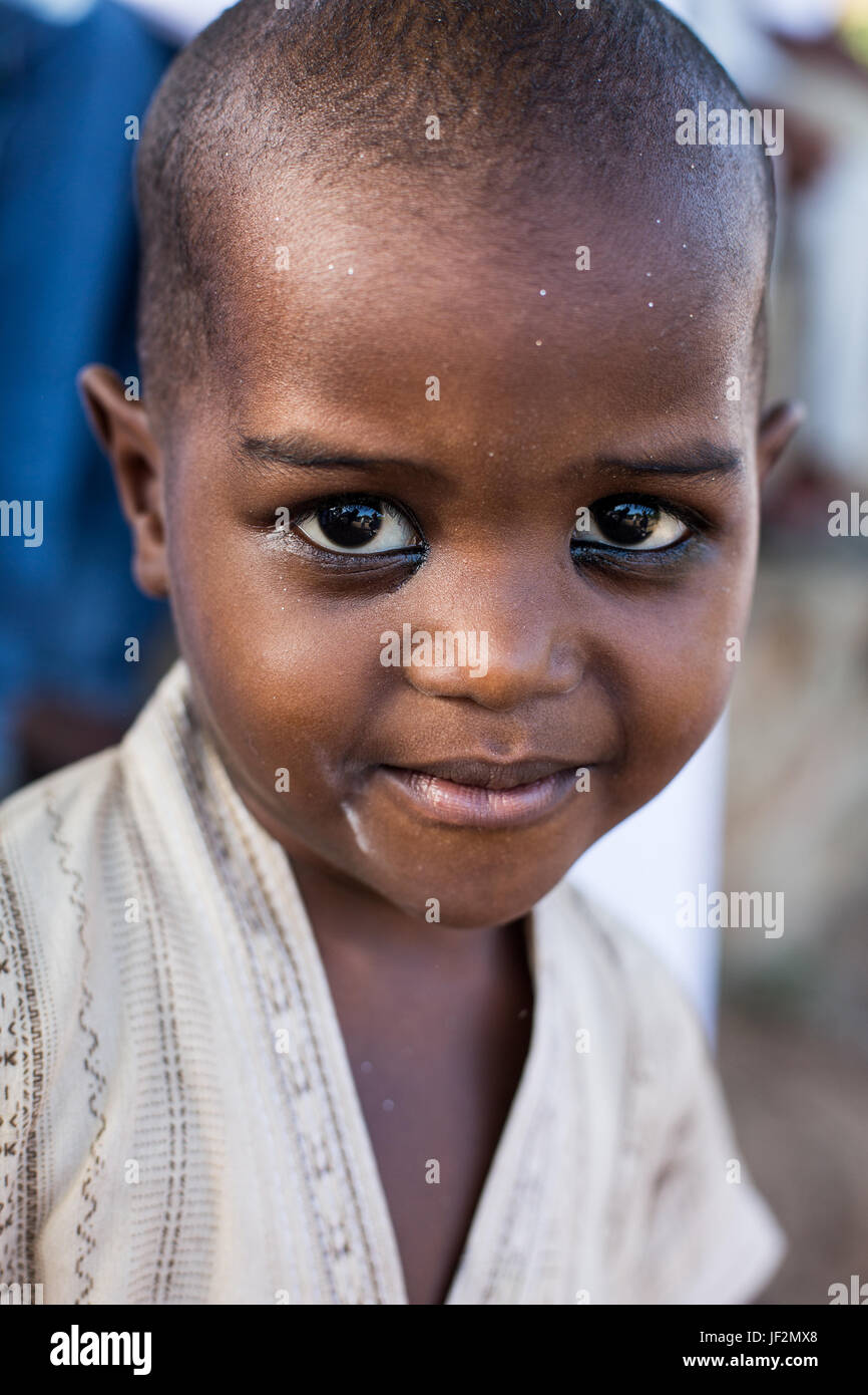 Portrait of a young Swahili child with kohl on her eyes, Lamu, Kenya - Stock Image