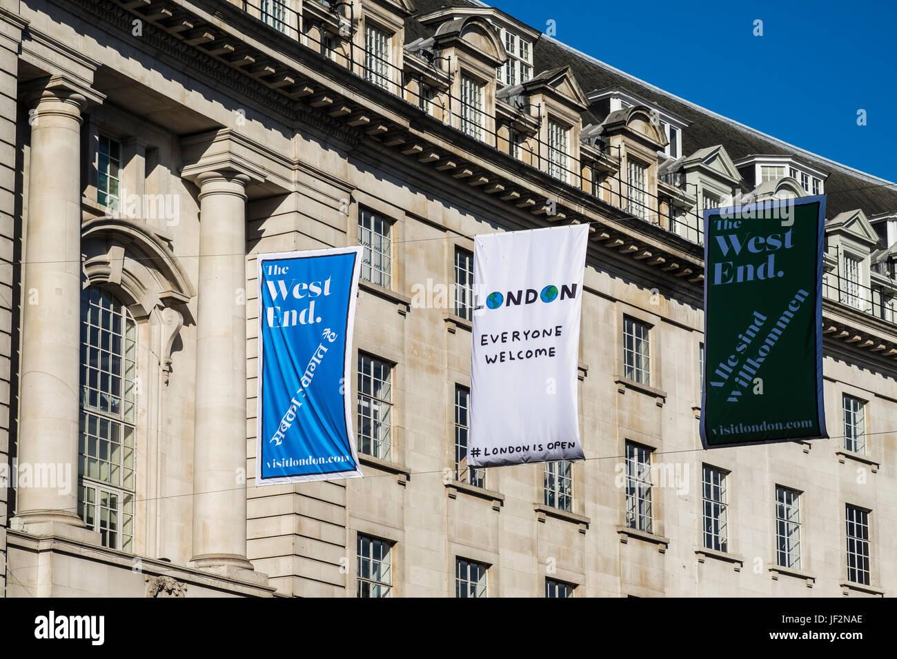 London everyone welcome & London is open banner across the street, London, England, U.K. - Stock Image