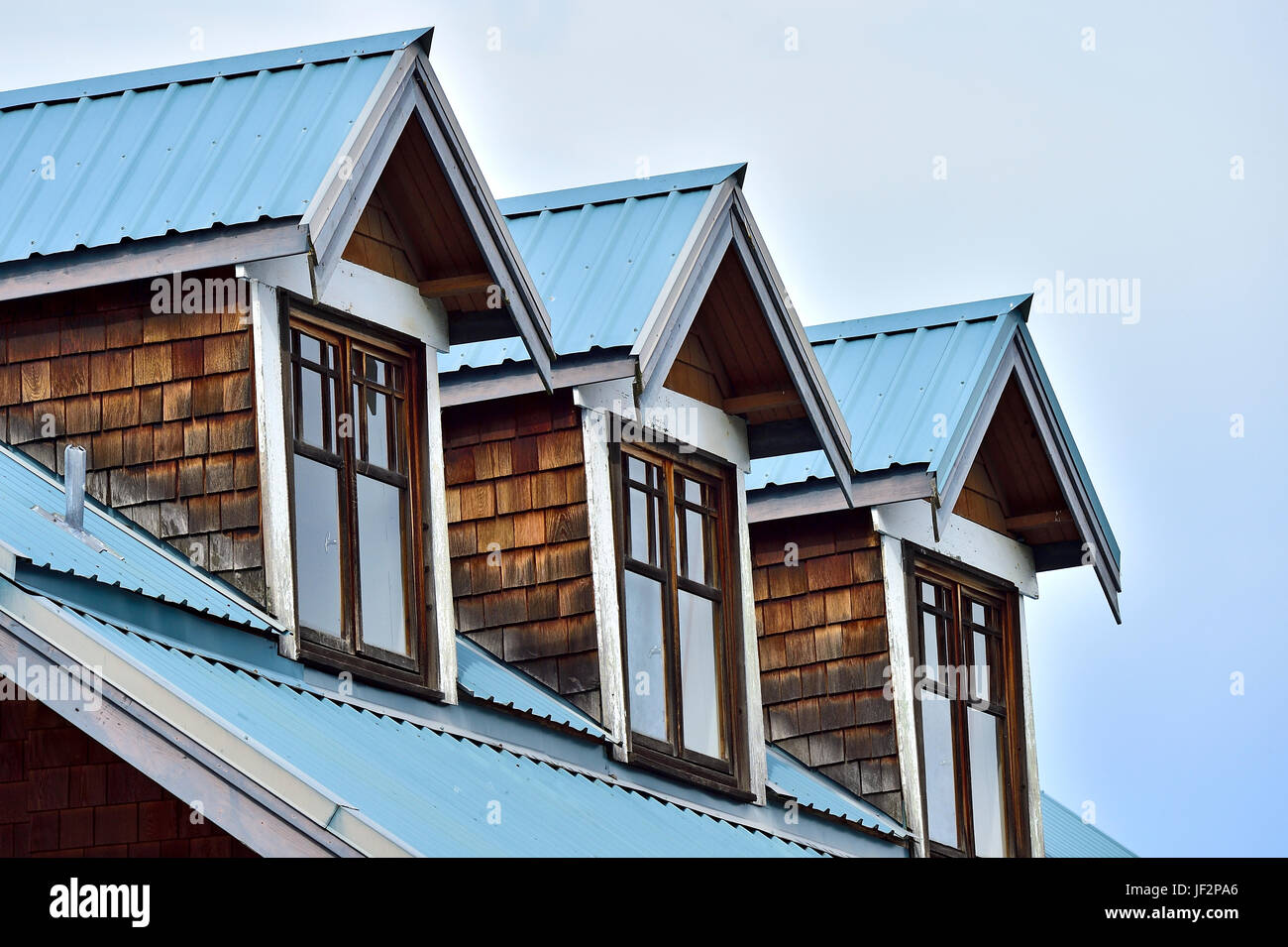 A Cottage Roof With Three Extended Windows On Vancouver