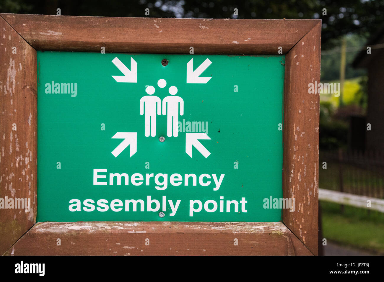 A sign saying: Emergency Assembly Point. A designated evacuation point in the event of a fire or other such emergency. - Stock Image