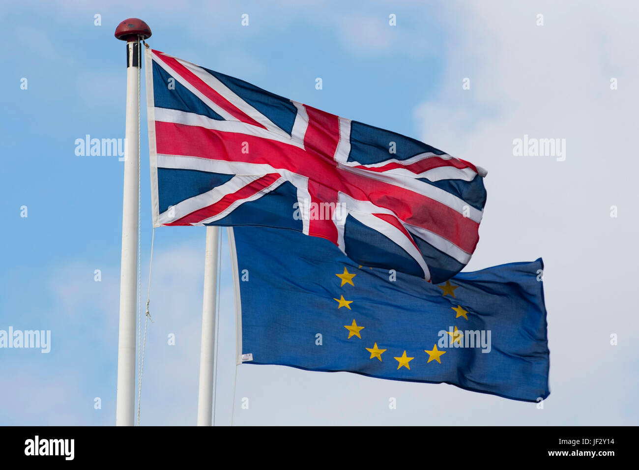 European Union and British Union Jack flags blow in the wind. The UK voted to leave the EU in a referendum. - Stock Image